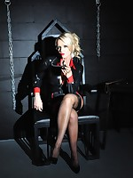 Horny Mistress Lucy Zara strips off in dungeon whilst playing with her kinky bondage gear